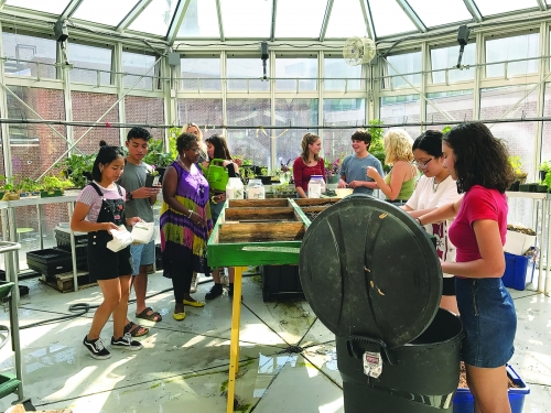 Students work in the greenhouse at Wilson High School