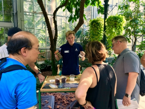 Intern Asa talks about Theobroma cacao (chocolate) with visitors