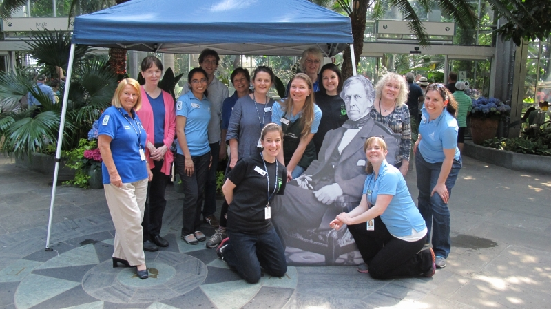 Volunteers and staff with cutout of Lt. Charles Wilkes